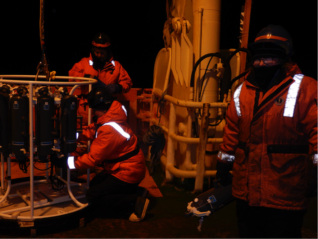 Team members Bettina Sohst (kneeling) and Casey O'Hara (right) load water samplers on to the trace metal CTD rosette for an early morning cast (photo: Bettina Sohst).