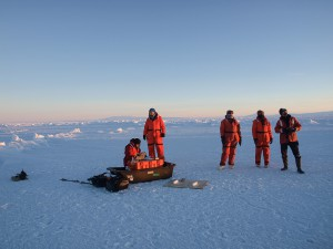 The UAS team (ground control, pilot, radio comms and observers) out on the ice